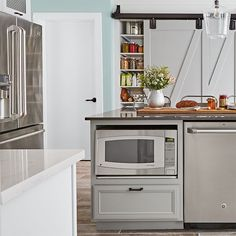 Kitchen island with built-in microwave.