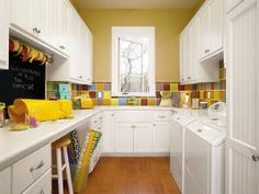 Laundry room/craft room idea. Great storage and workspace.