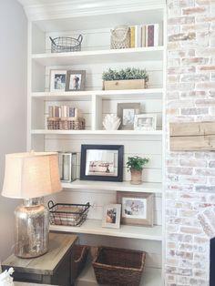Built-in bookshelves, styling, shiplap, whitewash brick fireplace, rustic mantle
