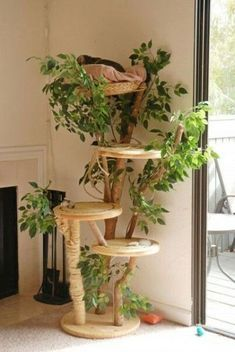 a nature inspired cat tree with branches, plywood platforms and lots of fake greenery and jute rope Diy Cat Tree, Cat Trees, Cat Tree House, Cat Shelves, Cat Playground, Cat Room, Cat Condo, Cat Decor, Decoration Home
