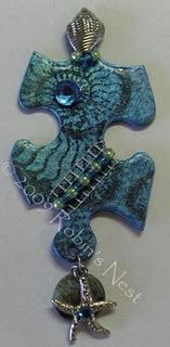 Altered puzzle piece - beautiful way to recycle too.