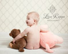 baby and stuffed animals from behind
