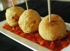 Fried Tamale on a Stick                Beef stuffed tamale that is steamed then fried and served with salsa on a stick.