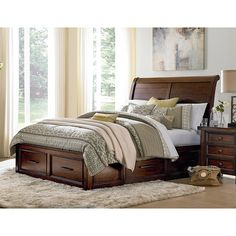 King storage bed has sleigh style headboard, footboard with two drawers and side rails with two drawers each rail. Six total drawers for added underbed storage. Stocked in Queen and King size.