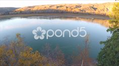 Aerial Shot Backward Over River Rocks Trees Field Drone Footage - Stock Footage   by RyanJonesFilms #aerial #drone #quadcopter #aerialshot #gopro #phantom #bridge #suspensionbridge #road #river #hills #trees #forest #water #dunvegan #canada