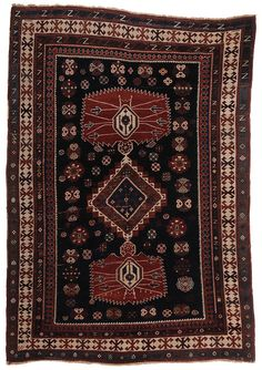 Kazak Rug - late 19th or early 20th century, three central medallions with stepped and serrated borders on cobalt ground, multiple borders with ivory, turquoise, green, and gold highlights, 5 ft. 6 in. x 7 ft. 10 in.