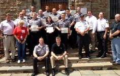 Lackawanna County Commissioner Patrick O'Malley and Lackawanna County Prison Warden Robert McMillan join with twelve new Lackawanna County Corrections officers who recently graduated from an intensive five-week training program that included instructions in intelligence, firearms and prison policies and procedures.