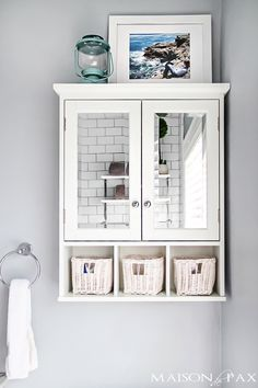 10 Tips for Designing a Small Bathroom I love this bathroom! Gorgeous finishes and brilliant ideas for space-efficient solutions when designing a small bathroom. Bathroom Storage Over Toilet, Bathroom Wall, Bathroom Interior, Bathroom Cabinets, Bathroom Vanities, Washroom, Bathroom Organization, Lowes Bathroom, Bathroom Hardware