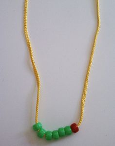 Minimalist very hungry caterpillar necklace makes me want to find charms of all the foods he ate.