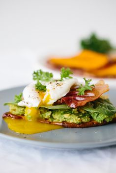 """Sweet Potato """"Toast"""" with Avocado, Spinach, Prosciutto and Poached Egg"""