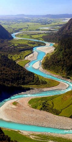 A meandering aquamarine river in the Westland District of  South Island, New Zealand.