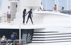 Don't look down! Kendall prepared to jump into the water as the other revellers took pictu...