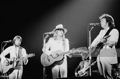 Dewey Bunnell, Gerry Beckley and Dan Peek (1950-2011) from English-American folk group America perform live on stage in New Haven, Connecticut, USA in May 1975.