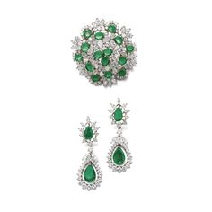 Pair of emerald and diamond ear clips and a brooch Each ear clip set with a pear-shaped emerald within a surround of brilliant-cut and marquise-shaped diamonds, supporting a detachable pendant similarly set; the brooch of cluster design, set with circular-cut and oval emeralds, pear-, marquise-shaped and brilliant-cut diamonds.