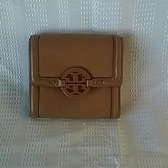 Tan Tory Burch Amanda Wallet Sad to see this go! Will consider a trade for a vibrant solid color zip around wristlet. Good condition with very light pen marks on leather inside by snap. One long but light pen mark on exterior by snap. (see photos, very light marks). Not original purchaser but it is easily authenticated online and on Posh  If I had any doubt, I would not sell. Tory Burch Bags Wallets