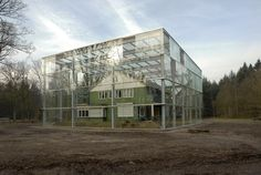 Evidently, you can put ANYTHING in a vitrine. Superintendent's house, Westerbork Concentration Camp. Ovin Architekten Landscape Architecture, Interior Architecture, Home Greenhouse, House In Nature, Timber House, Dezeen, Glass House, Building A House, Construction