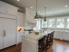 Functional Kitchen Island - Traditional Kitchen Renovation on HGTV Kitchen Island Lighting, Kitchen Lighting Fixtures, Kitchen Pendant Lighting, Kitchen Pendants, Pendant Lights, Light Fixtures, Paint Kitchen Cabinets Like A Pro, Kitchen Paint, Kitchen Doors