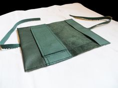 green tobacco pouch