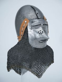 Basinet helmet with associated visor and aventail, about 1360-70.  Probably Germany  HAM #938.a. The Higgins Armory Museum.