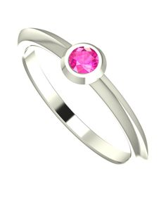 This modern and dainty white gold engagement ring will brighten up your day's, its contemporary band encapsulates a small but dazzling pink sapphire. The burnished setting contrasts the band of the ring making this a very unique and modern design.  #handmade #designer #engagement #rings #NudeJewellery #pink #sapphire