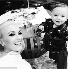 Note the smooth silver cuff bracelet on the table.  It has a resin or glass dome on the cylinder attached to it.   One stylish duo! Gwen Stefani posed for an Instagram selfie with 8-month-old son Apollo backstage at The Voice on Monday