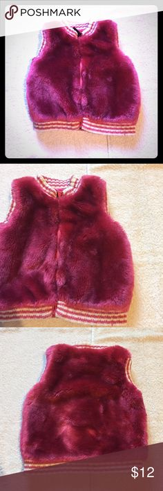 "Hot Pink Furry Vest Children's Place Hot Pink Furry Vest. In great condition. Perfect over a white or light pink sweater. Size 24 Months measures: 14"" long, 12"" across. Has side pockets and hot pink silky lining. Furry part is 85% acrylic, 15"" poly. Lining is 100% poly. 1216/250/11617 Children's Place Jackets & Coats Vests"