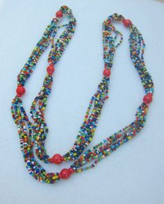 Long multi color multi strand glass beaded necklace with red beads by Framarines on Etsy