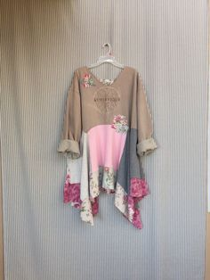 Upcycled Vintage Sweatshirt Lagenlook Dress Shabby Chic Patchwork Sweatshirt Dress Made with Various Romantic Pink Roses and Floral Knits Has a soft Pink Tan Gray Pastel Color Palette. This is oversized and has a large open Neckline with Rough Edges Cute to wear over a Lacy Tank top.  Patchwork Jersey and some soft Flannel Trim. Very Feminine and Soft . All 100% Cotton Measured laying flat 29 Across armpit to armpit 33-41 Long Free hips and waist