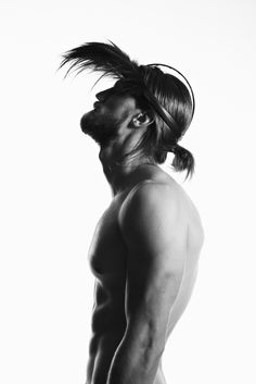 Photographer: Niklas Hoejlund www.niklashoejlund.com fashion photography black and white b/w male long hair beard muscles feather cap