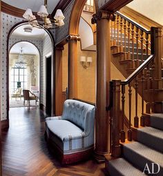 A staircase landing with Ionic columns and classical details | archdigest.com