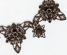 'Necklace of Berlin iron with Gothic tracery and foliage, c. 1820-30'