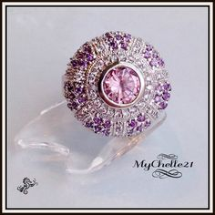 Big Puffed Crystal Disk Ring..Large Pink & Purple. Starting at $18