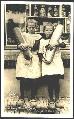 Two girls on their way home from the bakery in Cuijk Holland, Netherlands - photo postcard by A. Nielen of Cincinnati Ohio - 1920s.