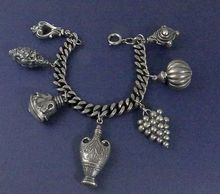 Sterling silver Etruscan large puffy charm bracelet