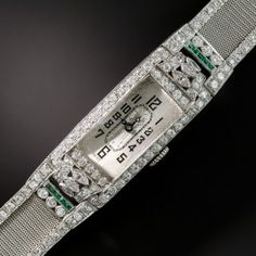The extreme elegance of a bygone era (1920s-30s) is beautifully embodied in this exemplary Art Deco bracelet watch expertly rendered in supple platinum mesh, outlined in small sparkling single-cut diamonds, and culminating in a stunning central timepiece embellished with small European-cut and marquise diamonds accented with bright green calibre emeralds. The high-quality movement is by the renowned Swiss watchmaker Glycine. 3.35 carats total diamond weight. 9/16 by 7 3/8 inches.