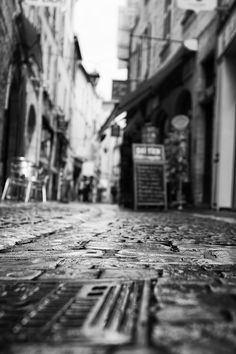 Cobblestone Path in a Shop Lined Alley - Black and White Fine Art Photography 5x7