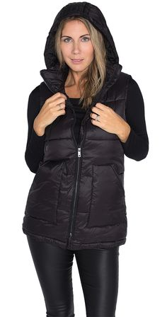 Positive Attitude Vest -  This puffy vest is the softest vest you've ever felt! Cut a little longer for comfort, this vest has an attached hood, front pockets and feels like you are surrounded by clouds...or fluffy pillows.  www.silvericing.com/lifestylist