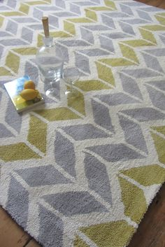 Arlo AR06 Chevron Lemon Grey Rug... Inspired colour competition in a cool chevron design theme. The rug maker calls it lemon, but we think it's more of a light mustard, while the grey is a light silver grey. It's a really refreshing, clean look. And it's made with a slim, smooth and very soft microfibre pile that's a delight to run your hand across.