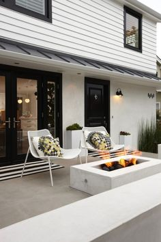 modern patio and exterior with fireplace / firepit