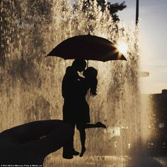 During sunset, what appears to be a silhouette of a couple kissing in the rain is really just a well-designed cut out at the Southbank fountains