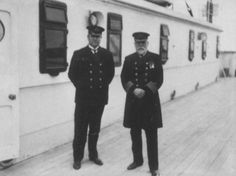 Historic photograph of Captain Smith and Chief Purser Hugh McElroy posing for a newspaper photographer on the starboard side of the Officers' Deckhouse shortly before Titanic's departure from Southampton