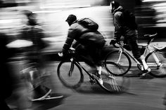 This photograph fits into the implied movement category where we can see a bicyclist riding his bicycle in a still effect while in the background we see fast paced movement. The essence of this this image was to capture the moment in time in which only the bicyclist is the main focus without the movement of the bicyclist.  http://digital-photography-school.com/a-beginners-to-capturing-motion-in-your-photography