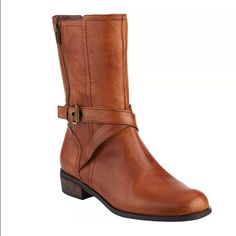 Cute Leather Boots ☃New!! ☃ In box! Marc Fisher LEATHER mid shaft boot! Saddle brown is the color of the boot. They are simply to die for beautiful! They are a size 9. Just too snug for my liking as I like to wear boot socks. In perfect condition! Marc Fisher Shoes Ankle Boots & Booties