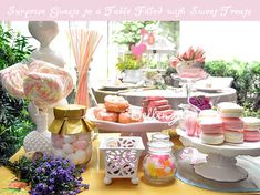 Sweets table for a garden-themed bridal shower - using vintage pastry stands, milk glass containers, porcelain tea cups