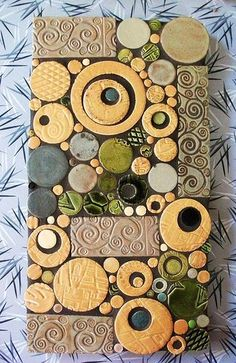 Took a class this weekend at Mercury Mosaic's in Minneapolis.  I've never worked with clay tiles before, it was very different from stained glass.  Lots of fun! This was also the first time I smeared glue over a large area and transferred my tiles.  A lot of my original design got lost towards the end and I was just sticking stuff where ever it fit.  I much prefer gluing each piece individually.