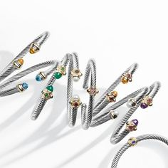 Cable bracelets with gemstones and 14k gold.