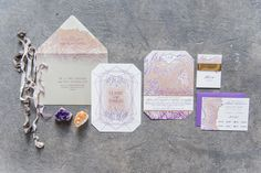 purple and peach wedding invitations - photo by Laura Kelly Photography http://ruffledblog.com/industrial-bohemian-geode-wedding