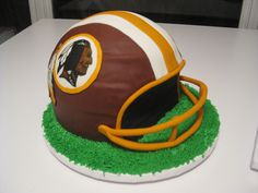 Washington Redskins Football Helmet Groom's Cake - Red velvet with cream cheese buttercream and MMF.  Logos were replicated on MMF also.