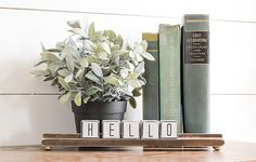 Dollar Tree wood alphabet blocks get  a modern farmhouse makeover, perfect for creating a desktop calendar or welcoming notes to guests.