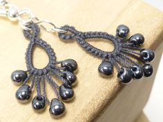 Drips are simple, versatile dangles that make a modern impact to everything you wear. The carefully graduated frill has an eye-catching sparkle that is simple enough for everyday wear and perfect for a night out. This variation of my Drips has glass beads shuttle-tatted into the design...thus Flash! Tatting is a knotted lace technique that is very strong. All my work is shuttle-tatted so my knots are small, firm and uniform. I use the highest quality 100% Egyptian cotton tatting cordonnet…